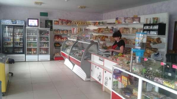 Магазин с пекарней и сто с цехом кузнеца