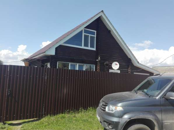Дом двух этажный деревянный