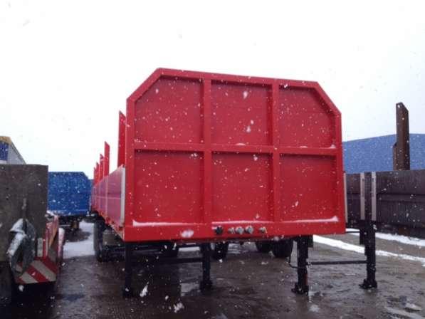 Полуприцеп бортовая площадка с раздвижными кониками повышеной проходимости