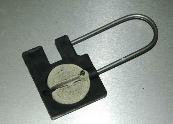 Опечатывающее устройство подвесное для дверей и сейфов