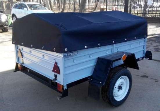 Прицеп для легкового автомобиля с V образным дышлом 1800х1250 с тентом и дугами в Москве Фото 5